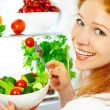 Woman eats healthy food vegetable vegetarian salad about refrige — Stock Photo #81429632