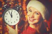 Merry Christmas! woman in Christmas hat with alarm clock — Stock Photo