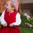 Little girl standing near fence — Stock Video #54364617