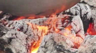 Bottom of pot over coals — Stock Video