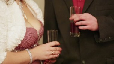 Man and woman holding glasses — Stockvideo