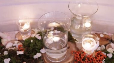 Burning candles in water glass — Stock Video