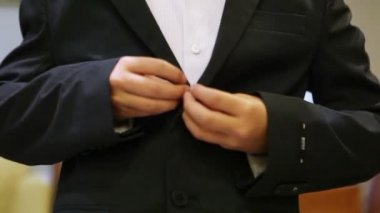 Fastening buttons on  jacket — Stock Video