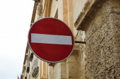 Restrictive sign on the ancient wall — Stock Photo