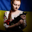 Ukrainian girl with a machine gun — Stock Photo #56630721