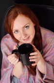 Happy woman with a teacup — Stock Photo