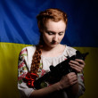 Ukrainian girl with a machine gun — Stock Photo #57035189