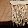 Постер, плакат: Edge of the wood table with a homespun towel