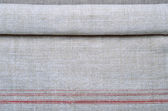 Close-up of the hemp homespun cloth with red stripe — Stock Photo