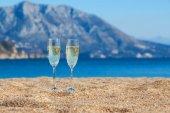 Wine glasses on a beach — Stock Photo