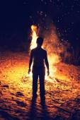 Boy near a bonfire — Stock Photo