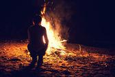 Boy near a bonfire — Stock Photo