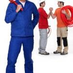 Three plumbers — Stock Photo #59106871