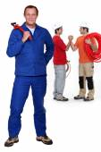 Three plumbers — Stock Photo