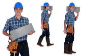 Worker carrying breeze block — Stock Photo