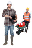 Two construction workers on a white background — Stock Photo