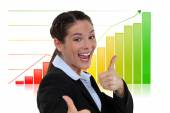 Excited businesswoman giving the thumbs-up — Stock Photo