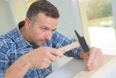 Carpenter using a hammer — Stock Photo