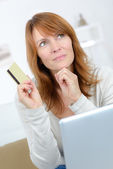 Woman doing some on-line shopping — Stock Photo