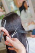 Brunette at the hair salon — Stock Photo