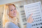 Woman at the opticians — Stock Photo