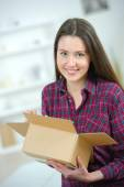 Woman holding a cardboard box — Stock Photo