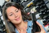 Brunette choosing wine — Stock Photo