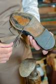 Gluing on new soles — Stock Photo