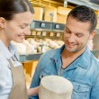 Giving advice in a cheese shop — Stock Photo #70178555