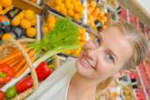 Lady holding basket of fruit & veg — Stock Photo