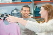 Couple clothes shopping together — Stock Photo