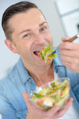 Man eating salad — Stock Photo