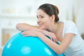Woman using an inflatable gym ball — Stock Photo