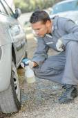 Mechanic cleaning a car — Stock Photo
