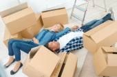 Couple tired from moving house — Stock Photo