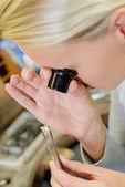 Female jeweller assessing a stone — Stock Photo