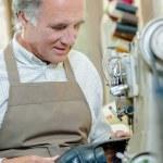 Cobbler in his workshop — Stock Photo #71184005