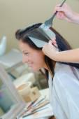 Brunette having her hair coloured — Stock Photo