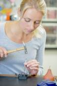 Woman replacing a watch strap — Stock Photo