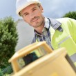 Cheerful site surveyor — Stock Photo #72087351