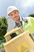 Cheerful site surveyor — Stock Photo