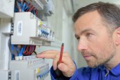Checking a fusebox is working — Stock Photo