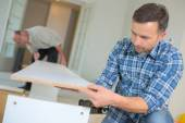 Putting together flap pack furniture — Stock Photo