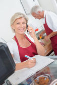 Butcher couple ordering stock — Stock Photo
