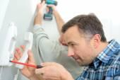 Man repairing an intercom phone — Stock Photo