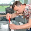 Handyman fixing the office printer — Stock Photo #72857915
