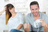 Chilling out at home with a games console — Stock Photo