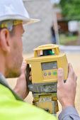 Surveyor taking a measurement — Stock Photo