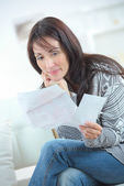 Woman sorting our her finances — Stock Photo