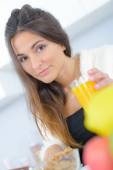 Grumpy woman with orange juice — Stock Photo
